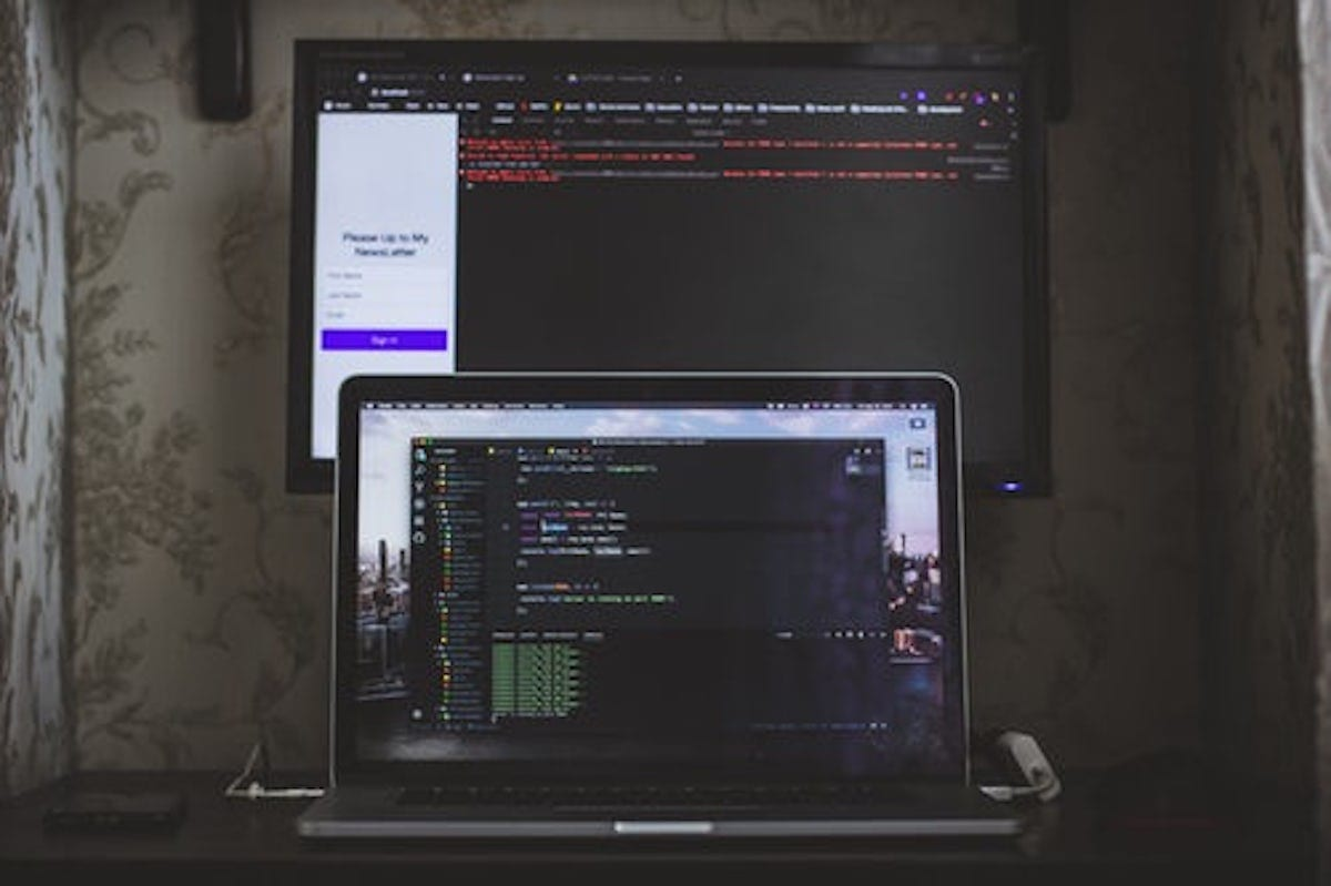 """MacBook Pro with coding on the screen"