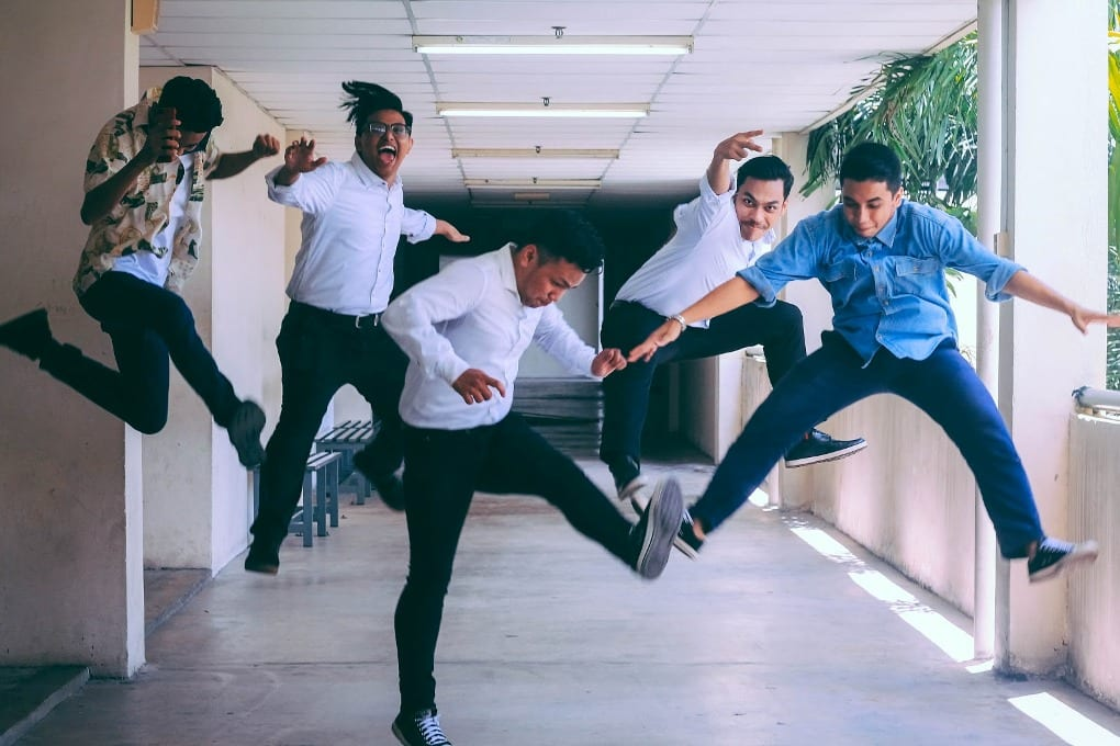 People jumping during a photoshoot.