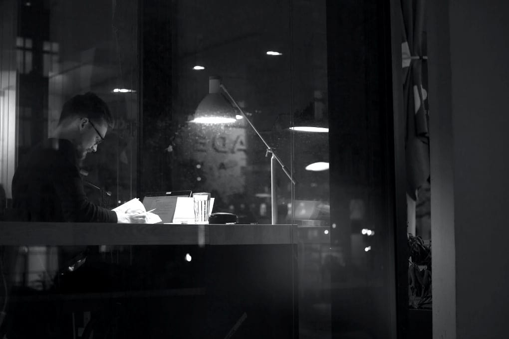 A young man studying in a coffee shop.