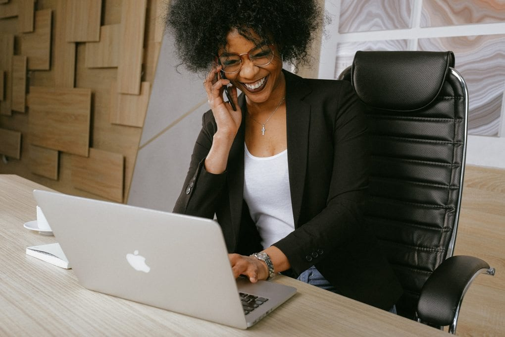 Woman in black blazer on computer