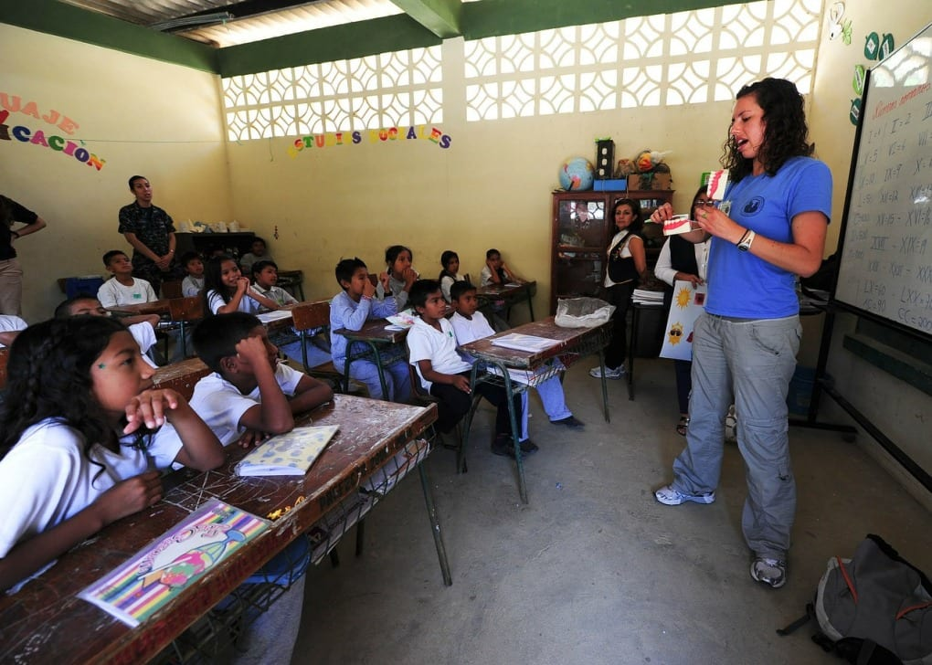 teacher standing in front of a classroom