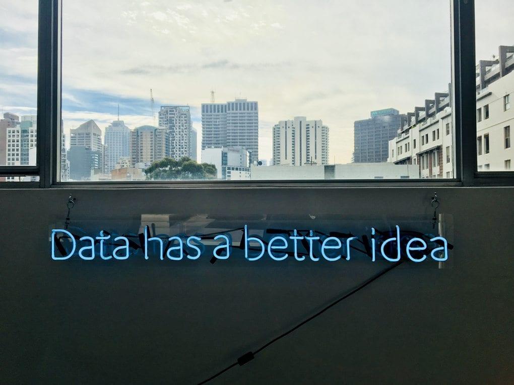 """A neon light sign reading: """"data has a better idea."""""""