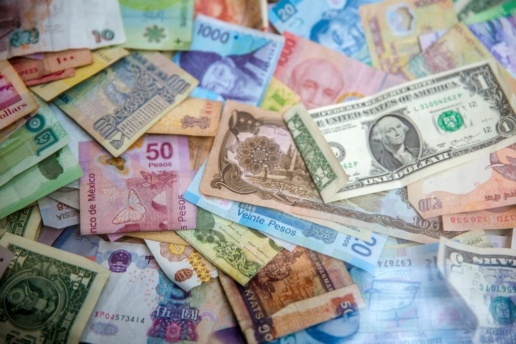 pile-of-money-in-many-different-currencies