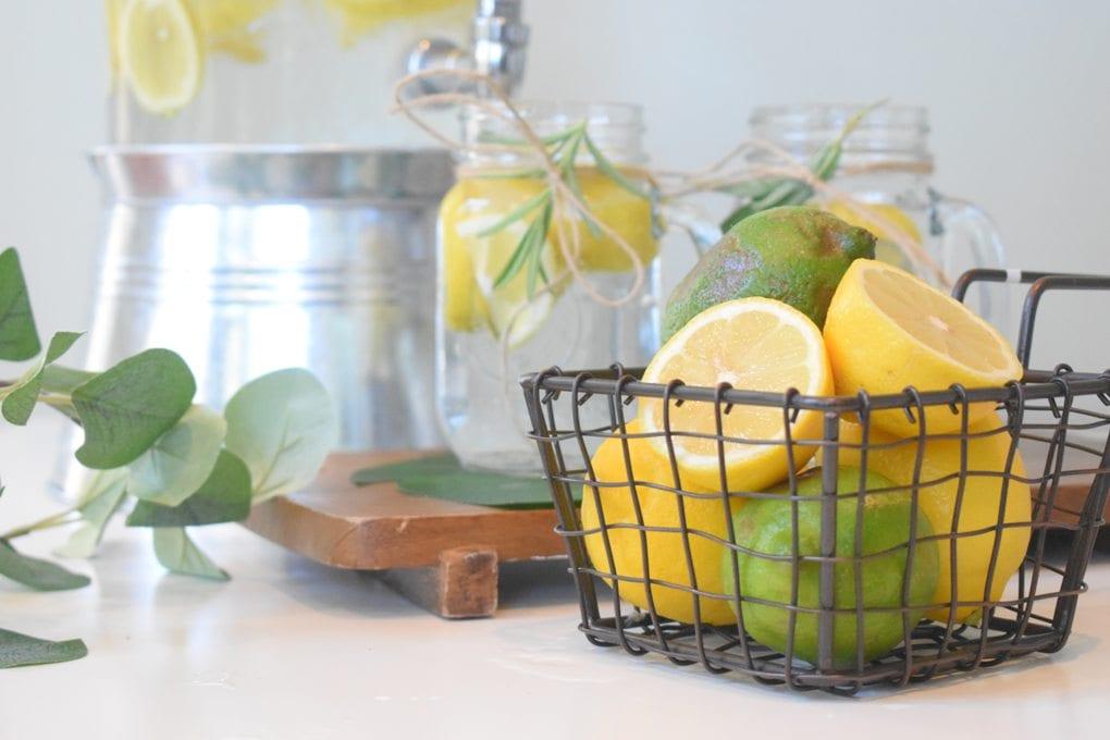 Lemons and limes with refreshing glasses of lemonade