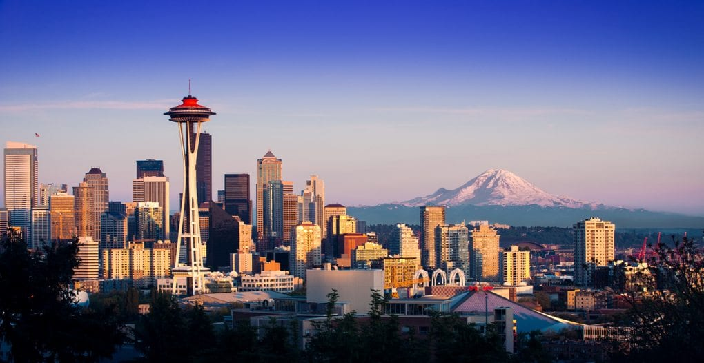 The Seattle skyline with the Space Needle and mountains in the background