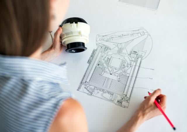A woman creates a mechanical sketch with her engineering skills