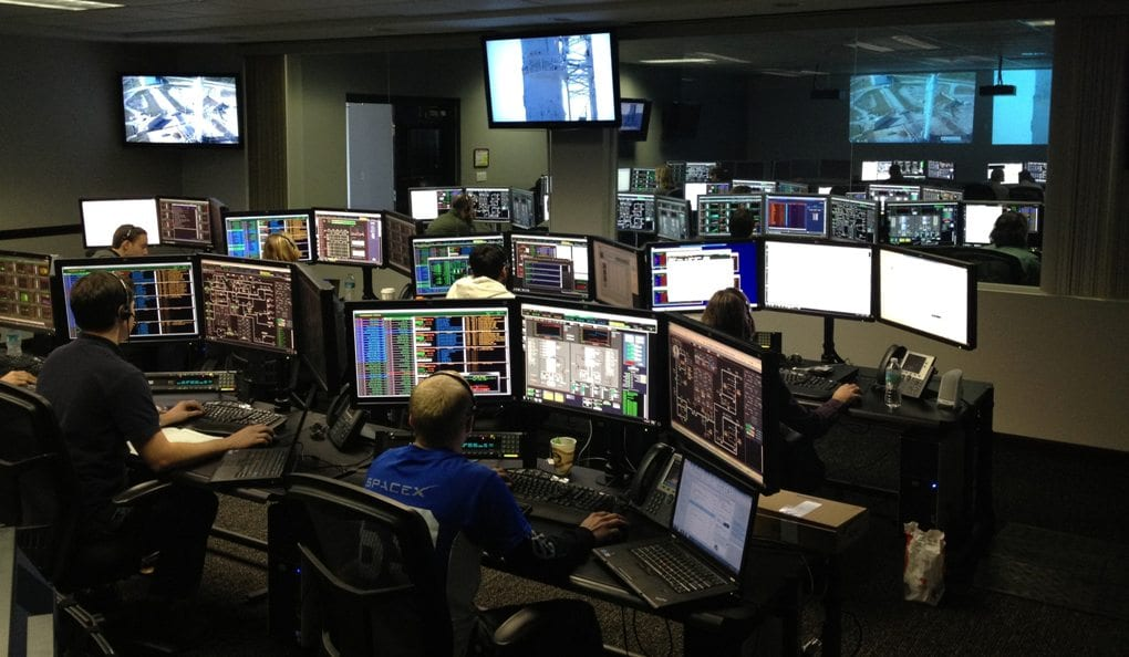 People working in a computer room
