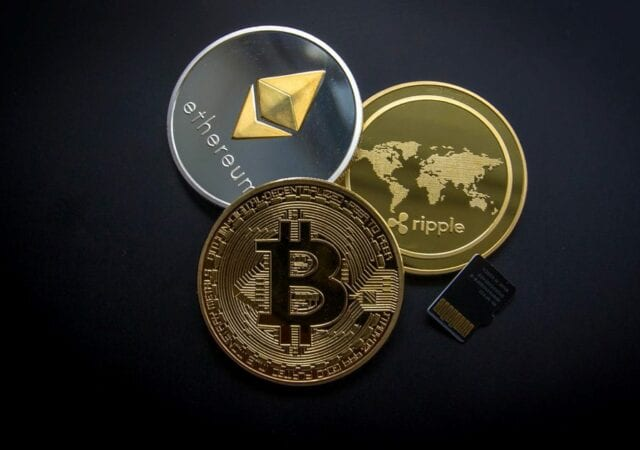 Three cryptocurrency coins Bitcoin, Ethereum, and Ripple