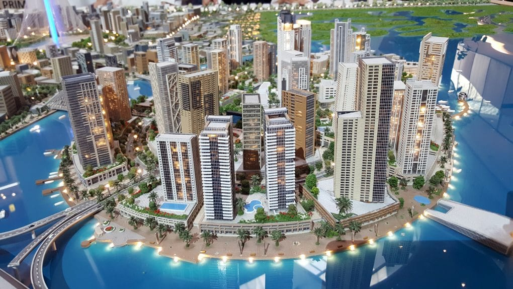 3D model of white skyscraper city surrounded by water