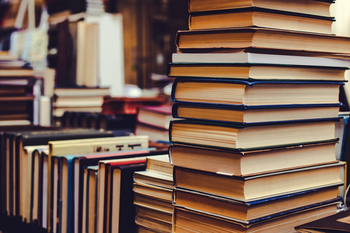A close up photo of a stack of books. jobs for history majors